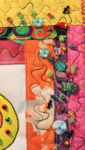 Close-up of beadwork top right