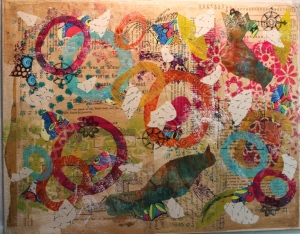 Step 5 - add more collage papers, paint and rubber stamps